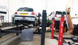 Mechanic doing a car service on a vehicle - Gladstone Tyres & Autocare Car Servicing York